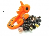 Orange dragon with girls bracelet