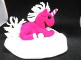 Pink unicorn on a cloud cake topper