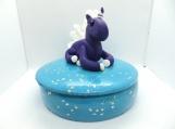 Purple unicorn on a jewelry box