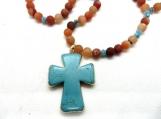 Turquoise cross with orange beads