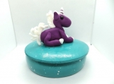 Unicorn on a jewelry box with stars