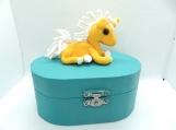 Oval jewelry box with a yellow unicorn