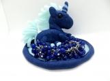 Blue unicorn and a cha cha bracelet