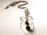 Black Memory Wire Pendant with a Vintage Flare