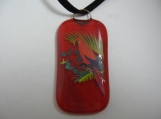 Brilliant red enamel parrot