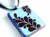 Brown fern on blue texture background wood pendant