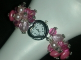 Charm bracelet style pink watch with heart watch face