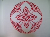 Completed Cross Stitch of a Red Floral Circular Design