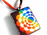 Rainbow flower on brown background pendant