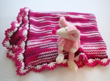 Handknitted cotton blanket for a baby girl