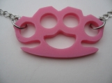 PINK PLASTIC BRASS KNUCKLES