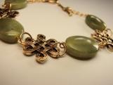 Olive jade with celtick conectors gold plated bracelet