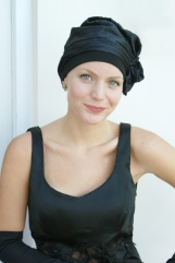Black cocktail evening hat with crystal pin for cancer patients