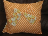 Retro orange and white polka dot cushion using designer, 'Amy Butler' fabric