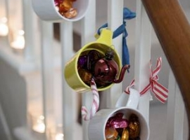 Christmas decorating mugs and ribbons