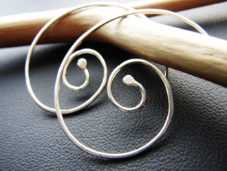 Nautilus hammered sterling silver earrings.