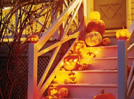 halloween porch decor with carved pumpkins
