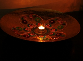 Rangoli or floral art on a bronze plate, Diwali