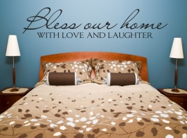 "wall decal reading ""bless our home with love & laughter"""