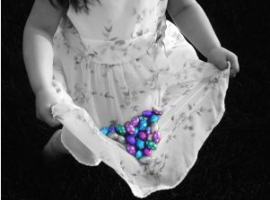 little girl gathering Easter eggs, easter egg hunt photo
