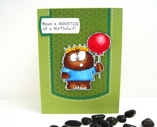 A masculine birthday card for a boy with a hand stamped monster.