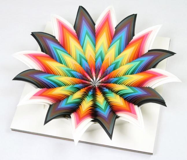 Jen Stark makes beautiful paper art.