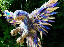 Hummingbird made out of shattered CDs.