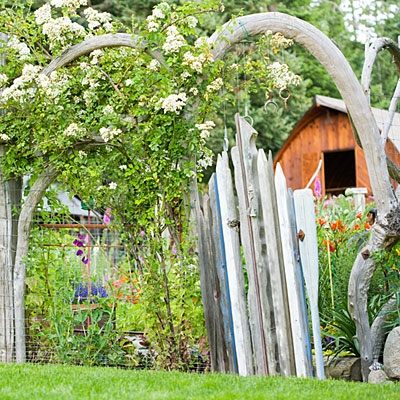 Garden gate made from old boat paddles.