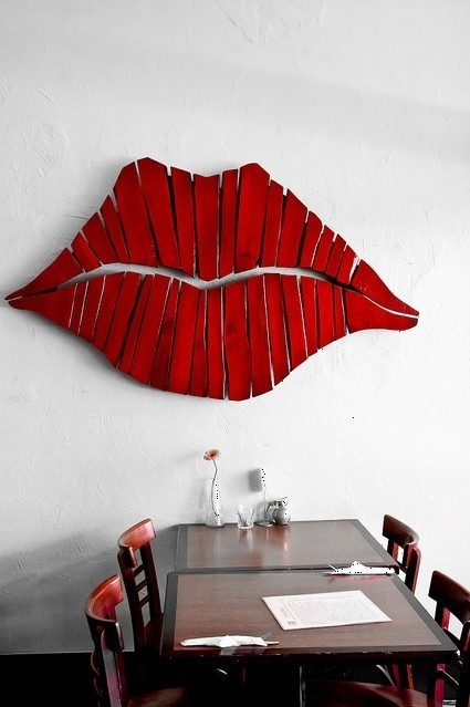 Lip wall art made from reclaimed wood.
