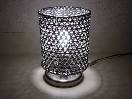 Lamp made of pop-tops of soda cans.