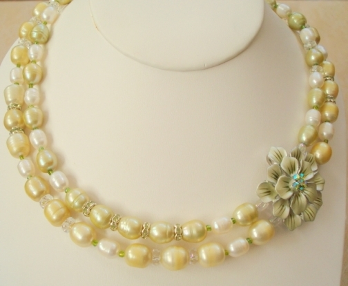 ENAMEL GREEN FLOWER AND PEARLS.