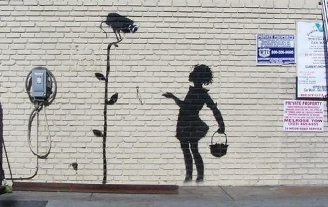 Banksy Los Angeles mural Flower Girl.